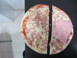 IMG 4076 266x200 ¿Cómo dividir una pizza para comer la misma cantidad de masa?